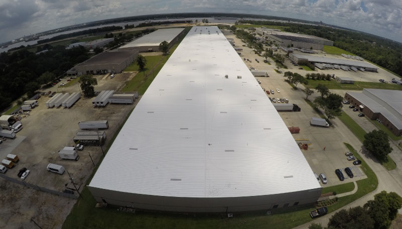 Image of large rooftop coated with fluid applied roof coating